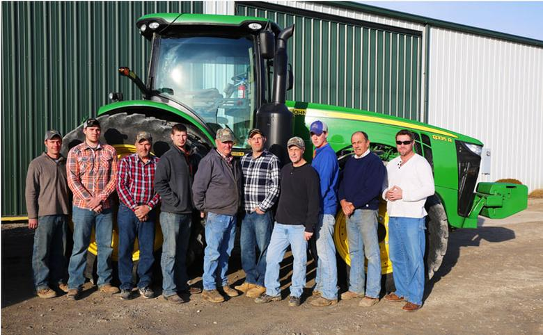 Picture of Grigsby staff in front of tractor
